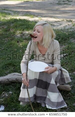 Nő táborhely eszik hotdog fa étel Stock fotó © IS2