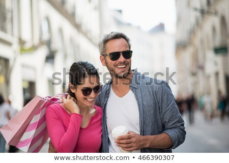 handsome young man holding shoulder bag and wearing sunglasses  Stock photo © feedough
