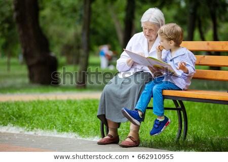дедушка и бабушка люди сидят скамейке зеленый парка Сток-фото © robuart