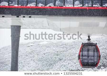 cablecar in high mountains during a snowstorm stock photo © lightpoet