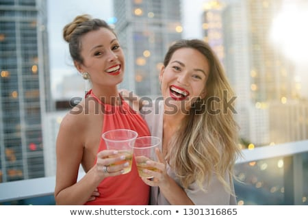 friends with non alcoholic drinks at rooftop party Stock photo © dolgachov