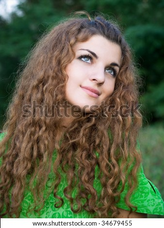 Young long-haired teen girl standing outside Stock photo © Lopolo