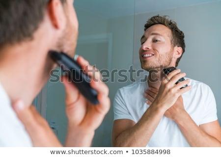Férfi szakáll elektromos körülvágó férfiszépség otthon Stock fotó © Maridav