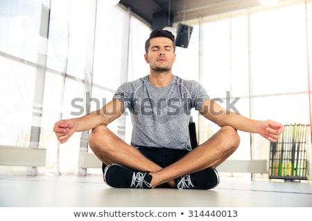 Handsome man meditating  Stock photo © wavebreak_media