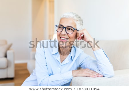 a woman wearing glasses Stock photo © photography33