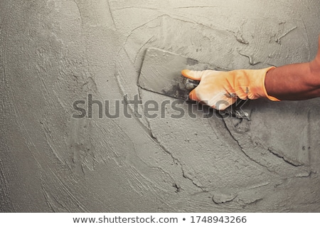 man spreading cement on wall stock photo © photography33