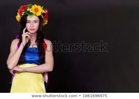 Woman standing wearing red dress hands in her hair on white background Stock photo © wavebreak_media