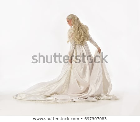 Stock photo: Beautiful bride in luxurious wedding dress with train isolated o