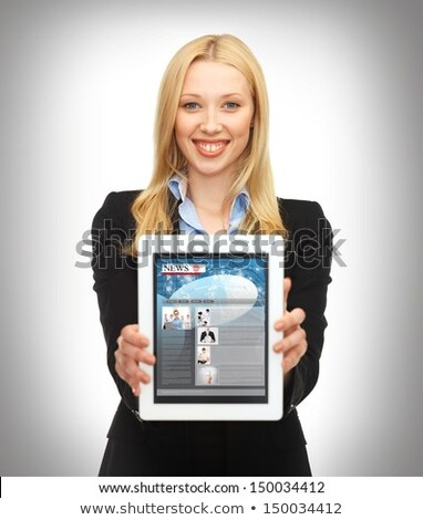 businesswoman holding digital tablet showing world news stock photo © wavebreak_media