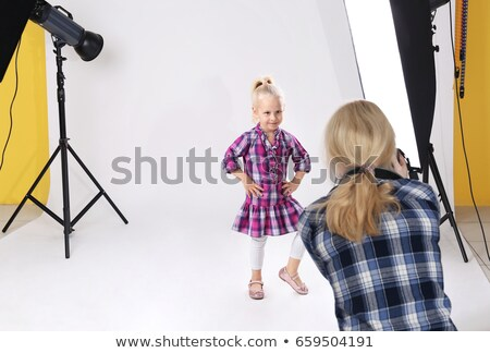 Portrait of photographer with photographic camera Stock photo © wavebreak_media