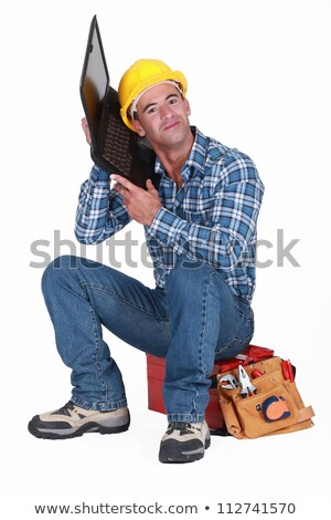 Workman listening to his laptop Stock photo © photography33
