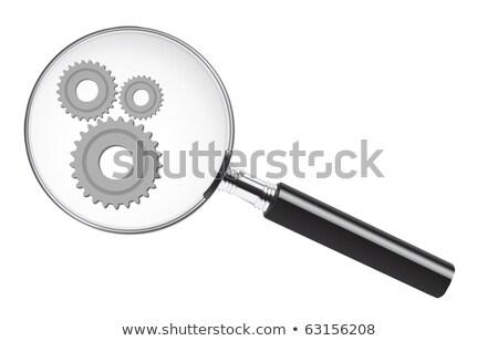 magnifying glass with turn on the brain icon stock photo © tashatuvango