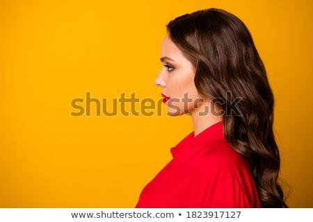 Gyönyörű nő néz rúzs fókusz nő lány Stock fotó © deandrobot