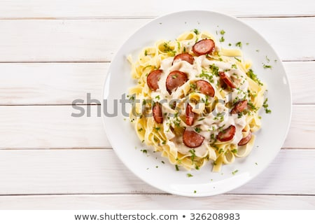 Spicy Spaghetti with sausage Stock photo © art9858