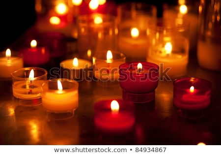 Temple candles in transparent chandeliers Stock photo © tang90246
