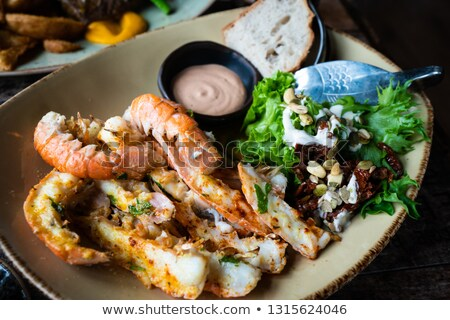 delicious grilled langoustines stock photo © zhekos
