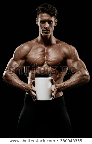 Muscular man with protein jars on white Stock photo © Elnur