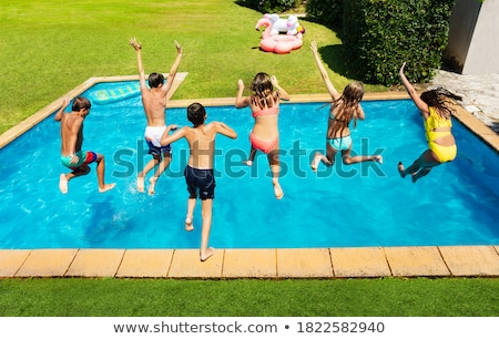 people jumping into pool stock photo © is2
