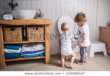 Baby WC łazienka w górę papier toaletowy Zdjęcia stock © Lopolo
