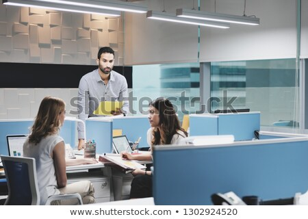 Man At Work Ignored by Female Colleagues In Coworking Space Stock photo © diego_cervo