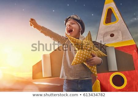 happy boy in astronaut costume stock photo © colematt