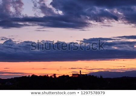 Sunset red sky with clouds above Conegliano city stock photo © frimufilms