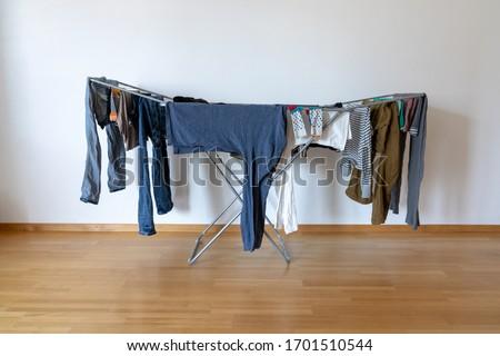 Vêtements rack chambre blanche coloré Photo stock © make