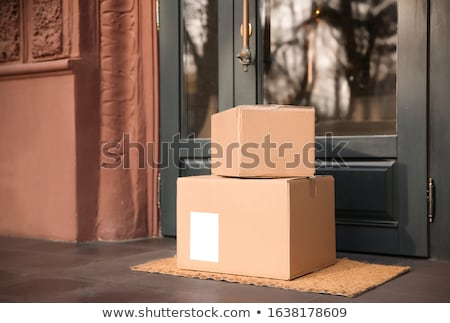 Delivery Of Parcel Boxes At Doorstep Stock photo © AndreyPopov