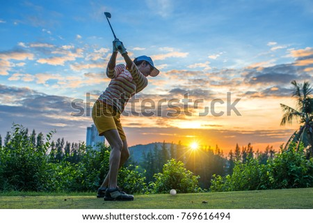 Golfer pitching at lake Stock photo © lichtmeister