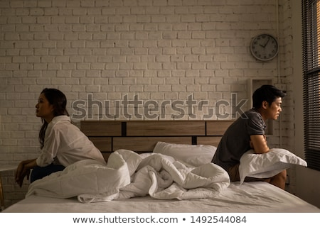 Couple arguing with each other in bedroom at home Stock photo © wavebreak_media
