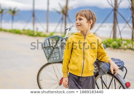 banner active blond kid boy driving bicycle in the park near the sea toddler child dreaming and hav stock photo © galitskaya