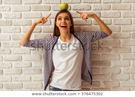 a woman holding an apple on her head Stock photo © photography33