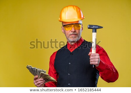 senior craftsman holding a spanner stock photo © photography33