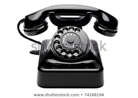 Old black phone on white Stock photo © perysty