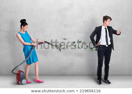 businessmans taking money from pocket stock photo © shutswis