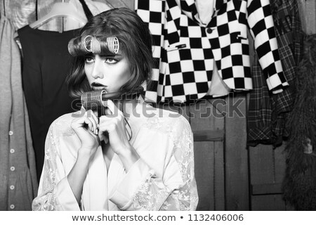 woman smiling with hair rollers Stock photo © carlodapino