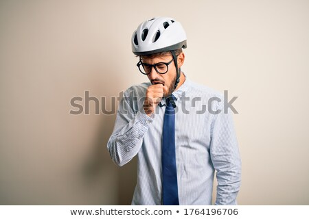 young ill businessman coughing isolated over white background  Stock photo © dacasdo