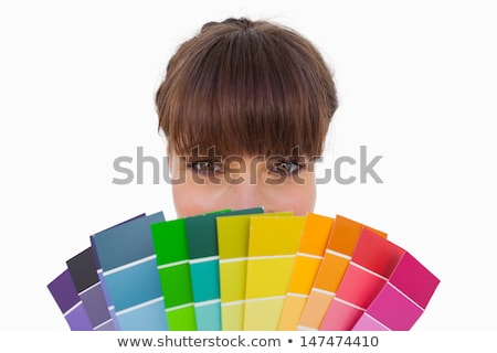 Pretty woman with fringe showing colour charts close up Stock photo © wavebreak_media