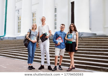 Four female friends looking at a folder Stock photo © AndreyPopov