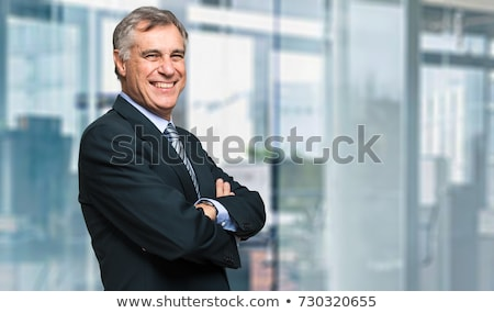 portret · gelukkig · zakenman · jonge · arm · permanente - stockfoto © AndreyPopov