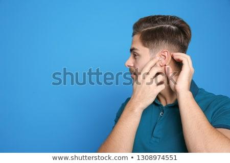 Férfi hallókészülék mögött fül mosoly arc Stock fotó © meinzahn