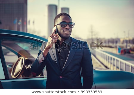 Well-dressed man in black suit with mobile phone Stock photo © Nejron