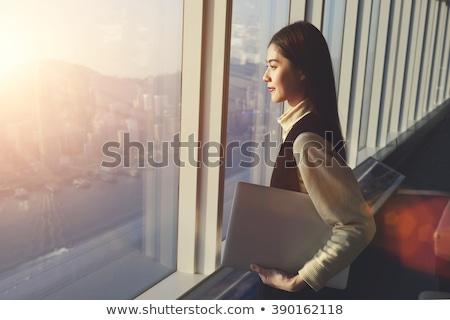 Figyelmes fiatal üzletasszony iroda áll csukott szemmel Stock fotó © wavebreak_media