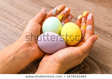 Kadın easter egg gülümseme çikolata paskalya yumurtası Stok fotoğraf © Flareimage
