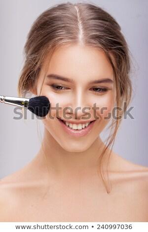 Retrato mulher jovem pele olhos azuis mão cara Foto stock © gromovataya