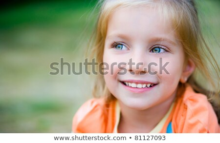 the blue-eyed blond on the grass Stock photo © Paha_L