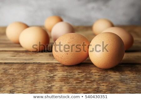 Farm fresh brown eggs on a wooden table Stock photo © ozgur