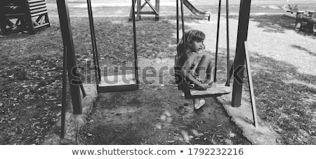 pretty sad woman on playground stock photo © aikon