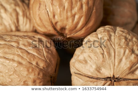 Walnut kernels and whole walnuts on rustic old table Stock photo © Valeriy
