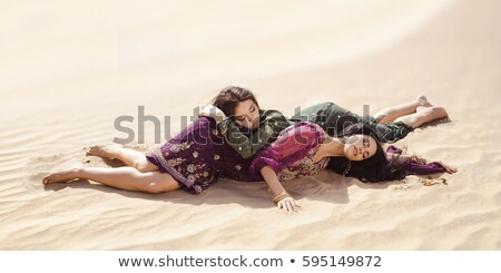Thirsty women traveling in desert. Lost in desert durind sandshtorm Stock photo © artfotodima